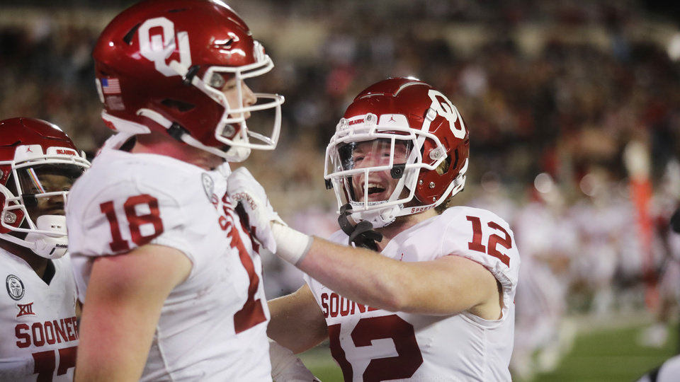 Photo - Oklahoma's Austin Stogner celebrates a touchdown catch with Drake Stoops during the first half of the team's NCAA college football game against Texas Tech on Saturday, Oct. 31, 2020, in Lubbock, Texas. (AP Photo/Mark Rogers)