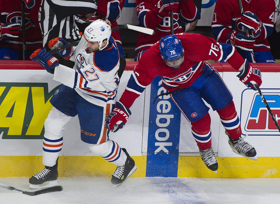 Photo - Montreal Canadiens' P.K. Subban, right, collides with Edmonton Oilers' Boyd Gordon during the first period of an NHL hockey game in Montreal, Tuesday, Oct. 22, 2013. (AP Photo/The Canadian Press, Graham Hughes)