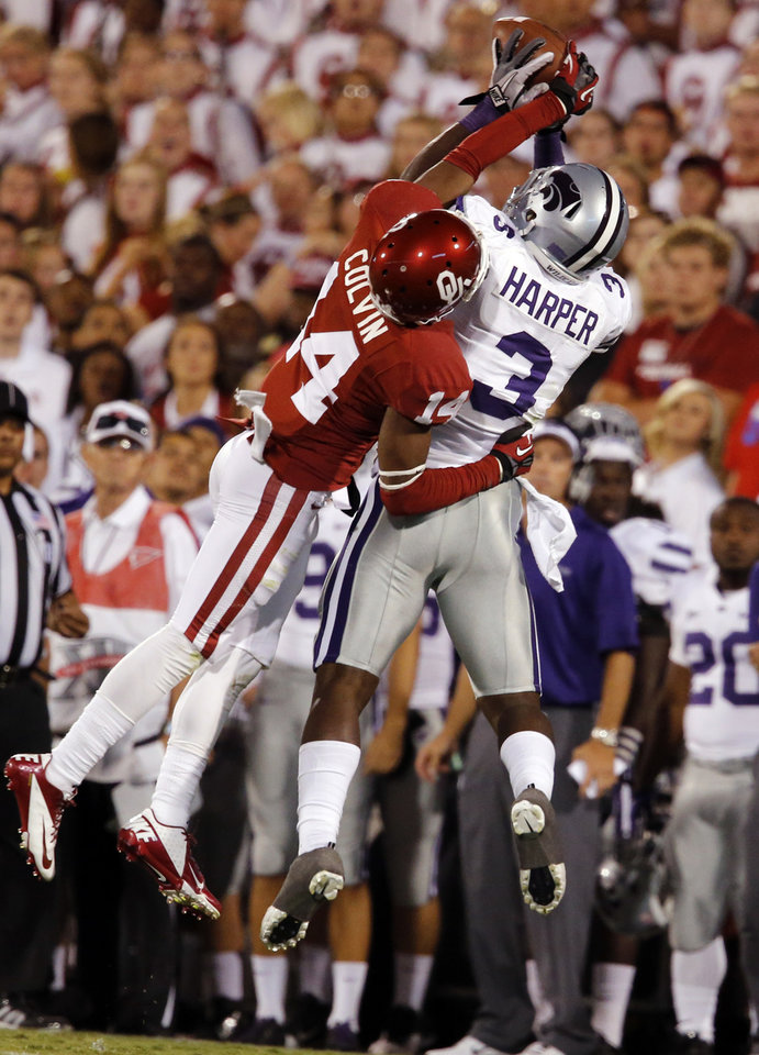 Photo - Chris Harper (3) snags a pass while defended by Aaron Colvin (14) during the second half of a college football game where the University of Oklahoma Sooners (OU) lost 24-19 to the Kansas State University Wildcats (KSU) at Gaylord Family-Oklahoma Memorial Stadium, Saturday, September 22, 2012. Photo by Steve Sisney, The Oklahoman