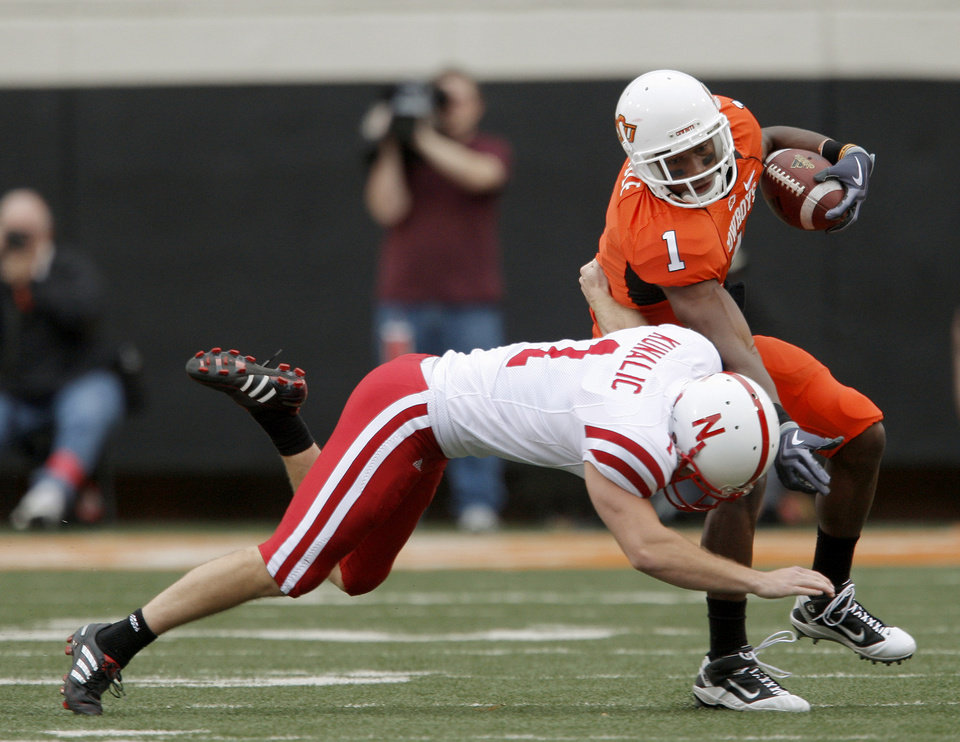 Photo - OSU's Joseph Randle is brought down by Nebraska's Adi Kunalic during the college football game between the Oklahoma State Cowboys (OSU) and the Nebraska Huskers (NU) at Boone Pickens Stadium in Stillwater, Okla., Saturday, Oct. 23, 2010. Photo by Bryan Terry, The Oklahoman