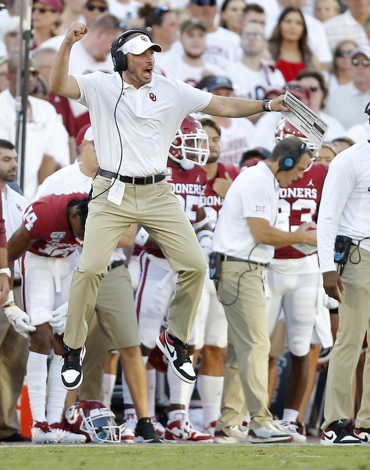 Photo - Oklahoma defensive coordinator Alex Grinch leaps during a college football game between the University of Oklahoma Sooners (OU) and the Houston Cougars at Gaylord Family-Oklahoma Memorial Stadium in Norman, Okla., Sunday, Sept. 1, 2019. [Bryan Terry/The Oklahoman]