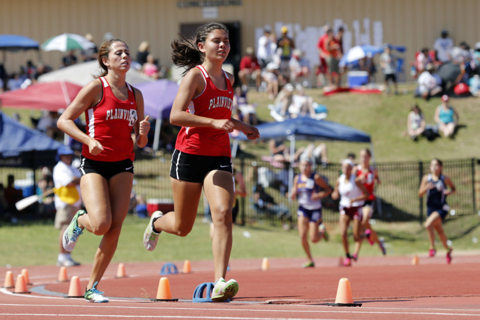 Photo - Plainview runners Madie Gray, right, and Jessica Woods outdistance the competition in the girls 1600 meters to place first and second during the Class 3A-4A state track meet at Moore Stadium on Saturday, May 10, 2014 in Moore, Okla.  Photo by Steve Sisney, The Oklahoman