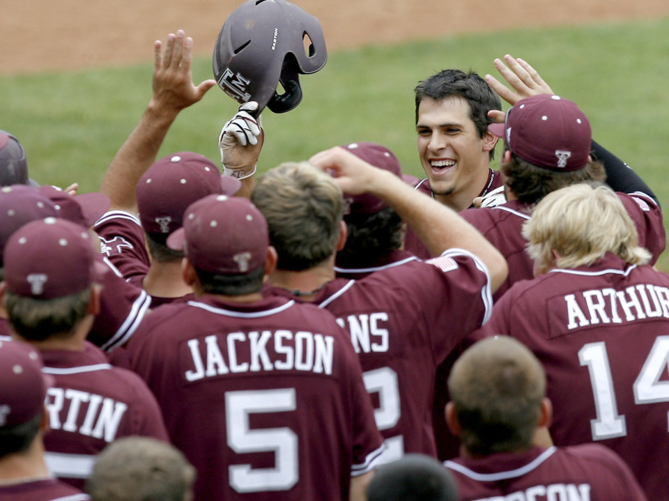 Texas A&M's Matt Juengel celebrates after hitting a home run in the fifth inning of a Big 12 baseball championship tournament game between Texas and Texas A&M at the Bricktown Ballpark in Oklahoma City, Saturday, May 29, 2010.  Photo by Bryan Terry, The Oklahoman