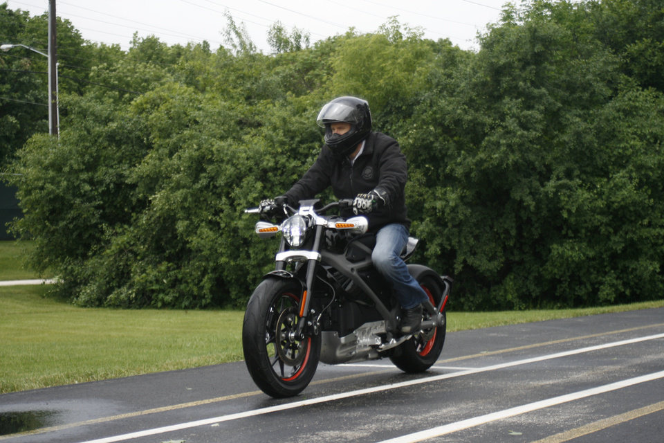 Photo - In this Wednesday, June 18, 2014 photo, employee Ben Lund demonstrates Harley's new electric motorcycle at Harley's research facility in Wauwatosa, Wis. The company plans to unveil the LiveWire model Monday, June 23, at an invitation-only event in New York. (AP Photo/M.L. Johnson)