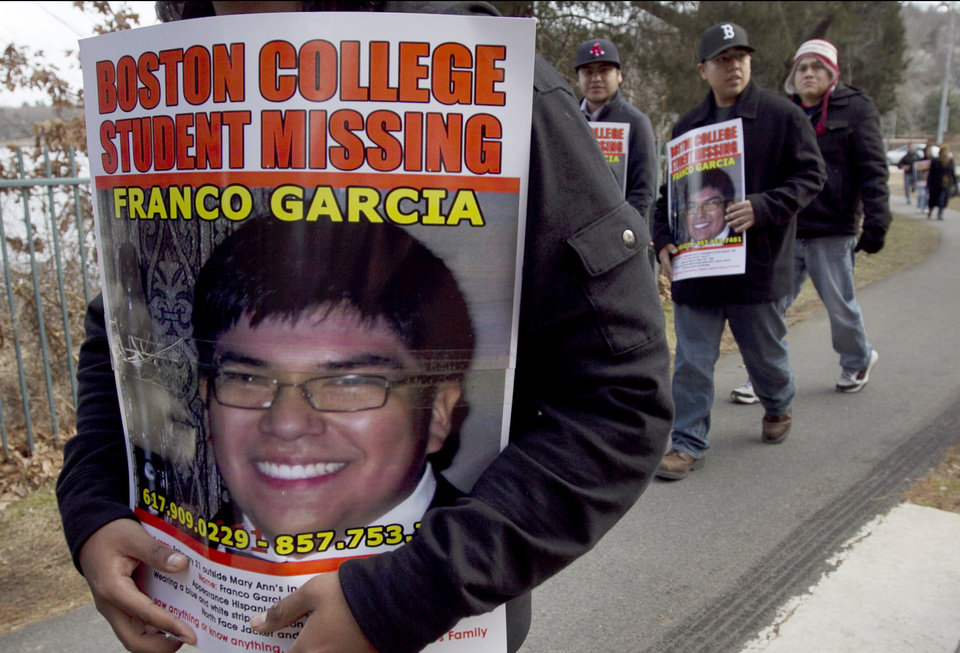 Photo -   FILE - In this Feb. 27, 2012 file photo, friends and family of missing Boston College student Franco Garcia carry placards bearing his photo while searching for him near the Chestnut Hill Reservoir in Boston. Garcia disappeared Feb. 22 after leaving a popular bar near the college. His body was recovered from the reservoir Wednesday, April 11, 2012. (AP Photo/Steven Senne, File)