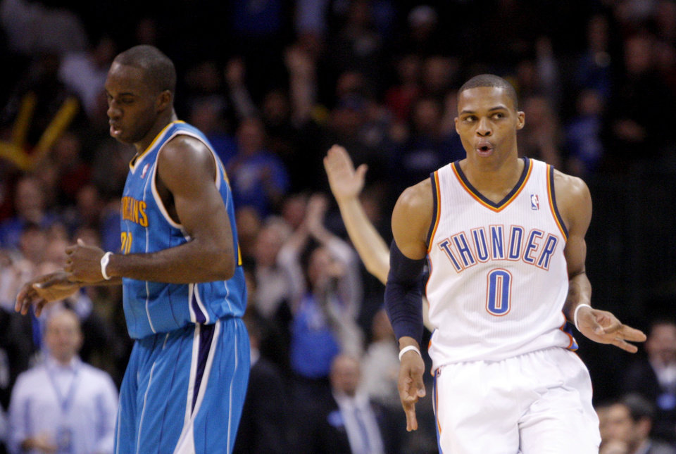 Photo - Oklahoma City's Russell Westbrook (0) celebrates a score late in the fourth quarter in front of New Orleans' Quincy Pondexter (20) during the NBA basketball game between Oklahoma City Thunder and New Orleans Hornet, Wednesday, Feb. 2, 2011 at the Oklahoma City Arena. Photo by Sarah Phipps, The Oklahoman