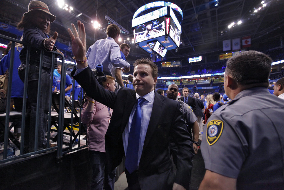Photo - Thunder coach Scott Brooks waves to fans as he makes his way off the court after the 107-103 win over Denver during the first round NBA playoff game between the Oklahoma City Thunder and the Denver Nuggets on Sunday, April 17, 2011, in Oklahoma City, Okla. Photo by Chris Landsberger, The Oklahoman