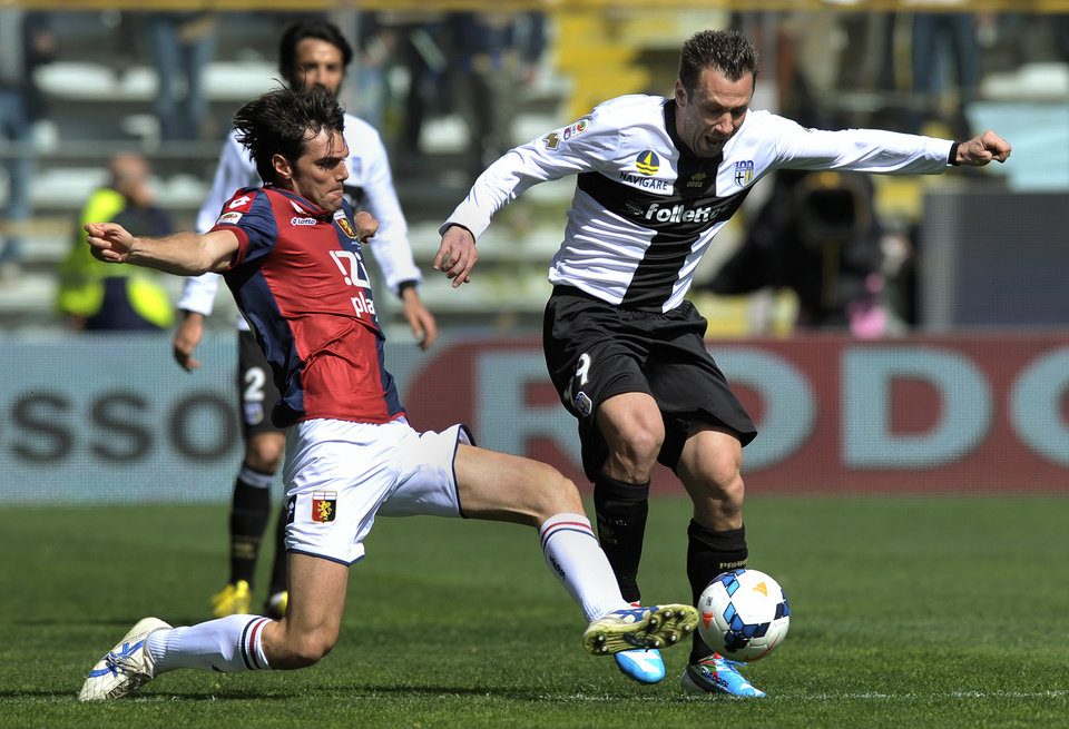 Photo - Parma's Antonio Antonio Cassano, right, vies for the ball with Genoa's Paolo De Ceglie, during their Serie A soccer match at Parma's Tardini stadium, Italy, Sunday, March 23, 2014. (AP Photo/Marco Vasini)