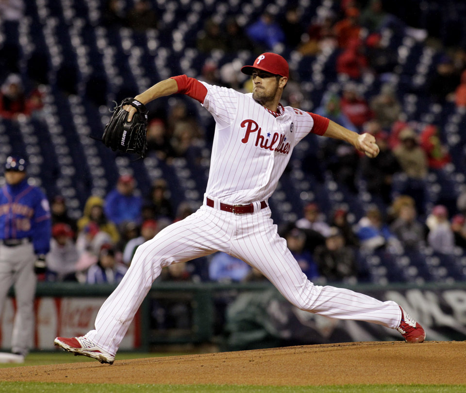 Photo - Philadelphia Phillies starting pitcher Cole Hamels winds up against the New York Mets in the first inning of a baseball game Tuesday, April 29, 2014, in Philadelphia. (AP Photo/H. Rumph Jr)