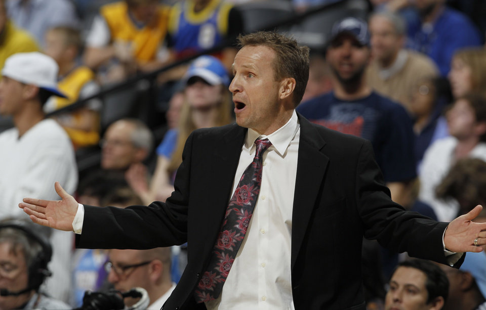 Oklahoma City Thunder head coach Scott Brooks reacts to a call against his team in overtime of an NBA basketball game against the Denver Nuggets in Denver on Sunday, Jan. 20, 2013. The Nuggets won 121-118 in overtime. (AP Photo/David Zalubowski)