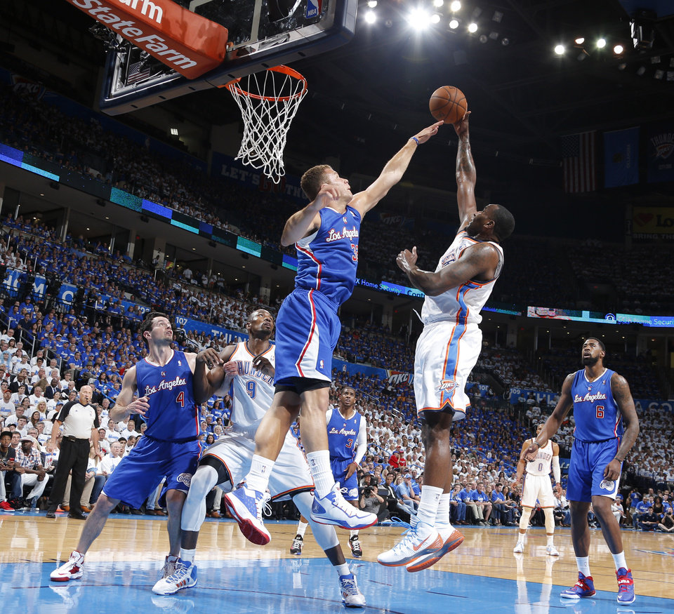 Kendrick Perkins (5) shoots over Blake Griffin (32) during Game 2 of the Western Conference semifinals in the NBA playoffs between the Oklahoma City Thunder and the Los Angeles Clippers at Chesapeake Energy Arena in Oklahoma City, Wednesday, May 7, 2014. Photo by Bryan Terry, The Oklahoman