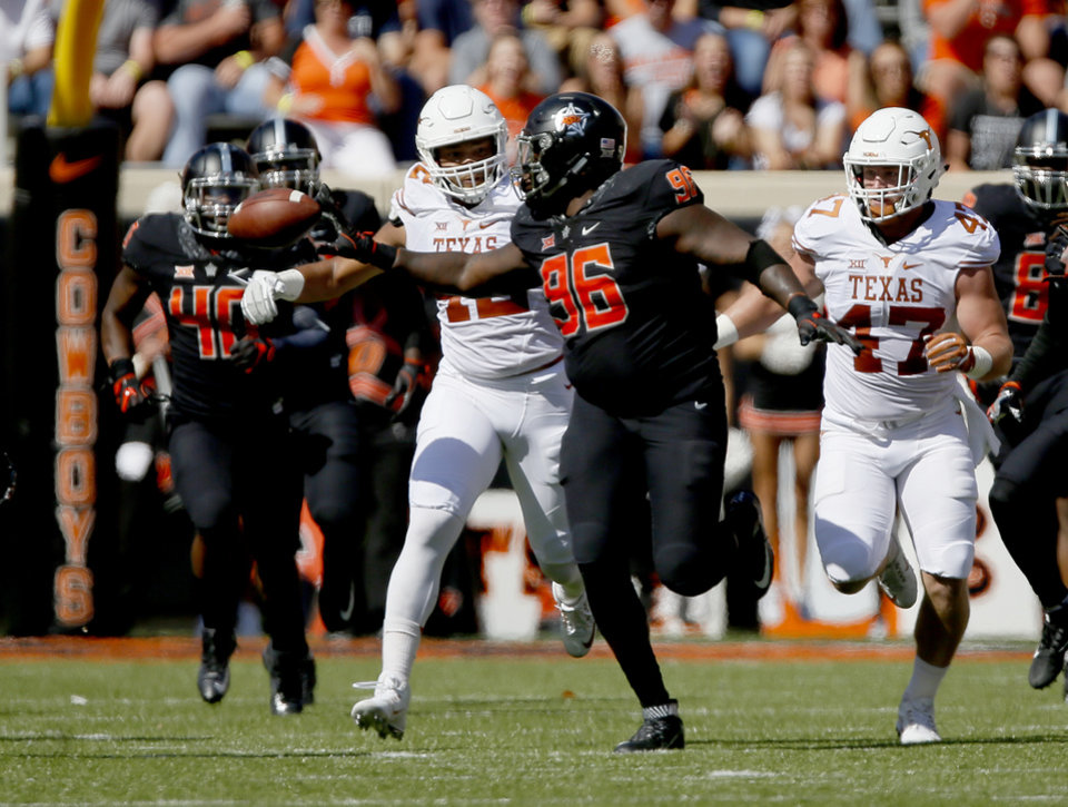 Photo -  Oklahoma State's Vincent Taylor (96) laterals the ball after recovering a blocked extra point in the October game against Texas at Boone Pickens Stadium. Taylor is a finalist for the Piesman Trophy. [PHOTO BY SARAH PHIPPS, THE OKLAHOMAN]