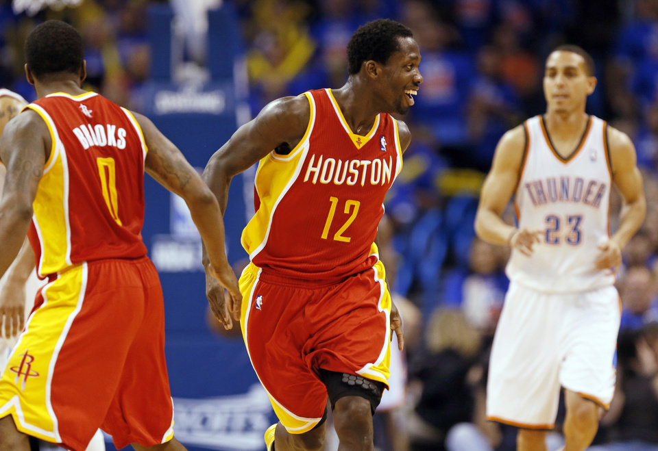 Photo - Houston's Patrick Beverley (12) celebrates with Aaron Brooks (0) as they run back on defense in front of Oklahoma City's Kevin Martin (23) after hitting a 3-point shot in the second half during Game 5 in the first round of the NBA playoffs between the Oklahoma City Thunder and the Houston Rockets at Chesapeake Energy Arena in Oklahoma City, Wednesday, May 1, 2013. Photo by Nate Billings, The Oklahoman