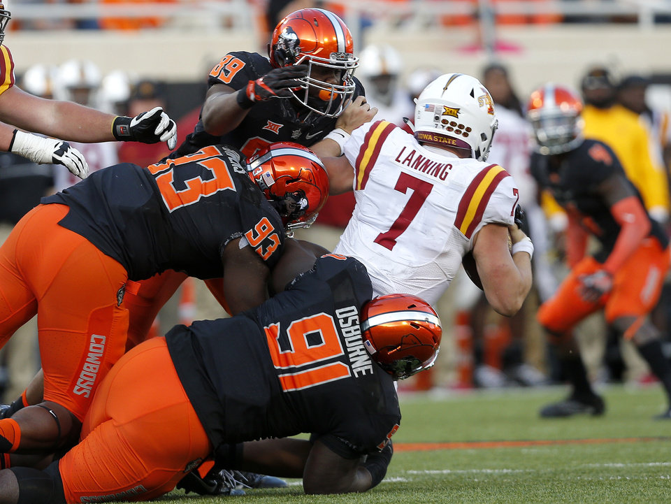 Photo - Oklahoma State's DeQuinton Osborne (91), Jarrell Owens (93) and Tralund Webber (89) sack Iowa State's Joel Lanning (7) late in the fourth quarter during a college football game between the Oklahoma State University Cowboys (OSU) and the Iowa State University at Boone Pickens Stadium in Stillwater, Okla., Saturday, Oct. 8, 2016. Photo by Sarah Phipps, The Oklahoman