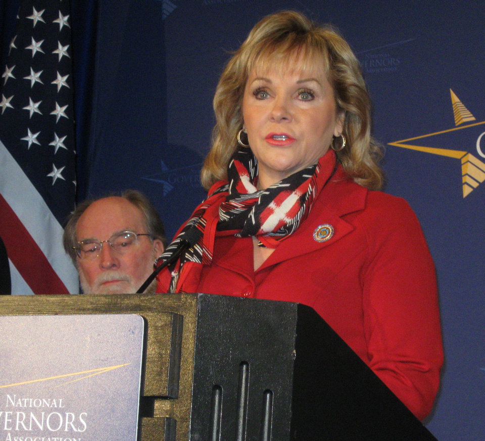 Gov. Mary Falllin speaks at a news conference in Washington DC on Saturday at the start of the National Governors Association's winter conference. Hawaii Gov. Neil Abercrombie is behind Fallin. <strong>Chris Casteel - The Oklahoman</strong>