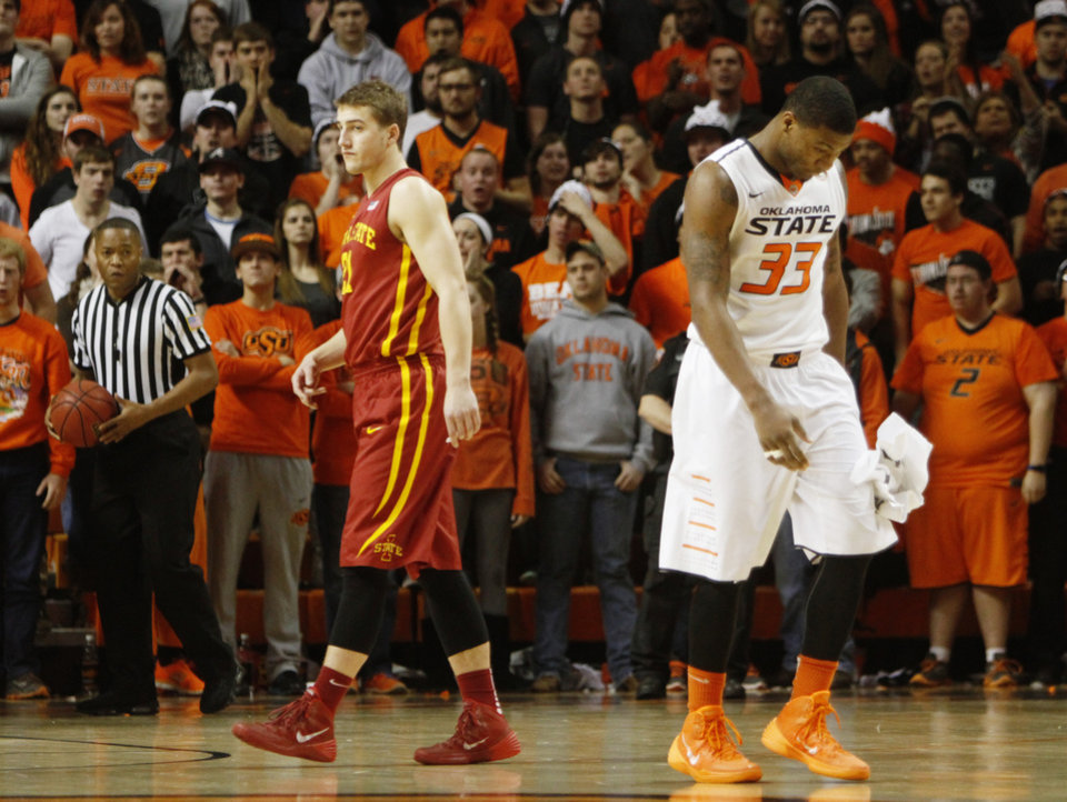 Oklahoma State\'s Marcus Smart (33) walks off the court with his head down after being called for a foul during an NCAA college basketball game between Oklahoma State University (OSU) and Iowa State at Gallagher-Iba Arena in Stillwater, Okla., Monday, Feb. 3, 2014. Photo by KT King, The Oklahoman
