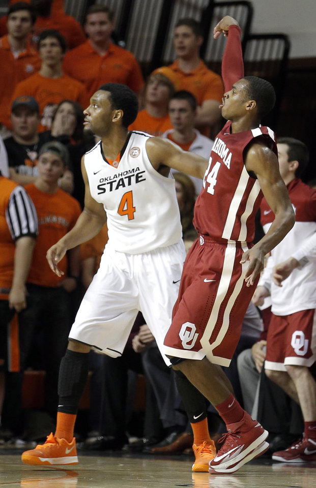 Photo - Oklahoma's Buddy Hield (24) watches his three-point shot in front of Oklahoma State's Brian Williams (4) during the men's Bedlam college game between Oklahoma and Oklahoma State at Gallagher-Iba Arena in Stillwater, Okla., Saturday, Feb. 15, 2014. Photo by Sarah Phipps, The Oklahoman