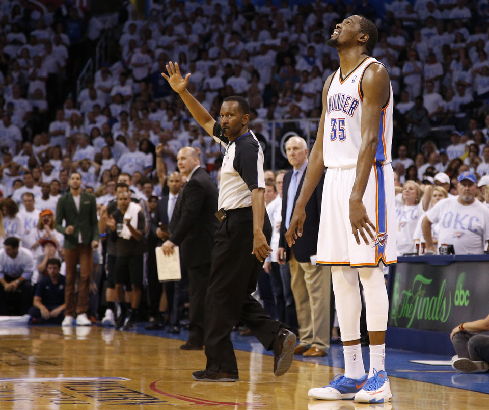 Oklahoma City\'s Kevin Durant (35) reacts after missing a shot late in overtime of Game 6 of the Western Conference Finals in the NBA playoffs between the Oklahoma City Thunder and the San Antonio Spurs at Chesapeake Energy Arena in Oklahoma City, Saturday, May 31, 2014. Oklahoma City lost 112-107. Photo by Bryan Terry, The Oklahoman
