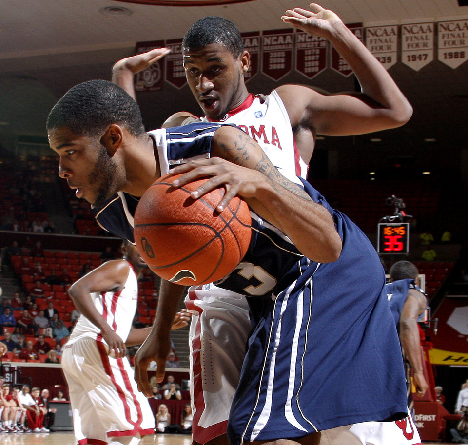 ORAL ROBERTS UNIVERSITY / OU / ORU: Oklahoma's Steven Pledger (2) defends Oral Roberts' Warren Niles (13) during an NCAA men's college basketball game between the University of Oklahoma Sooners (OU) and the Oral Roberts Golden Eagles at the Lloyd Noble Center on Thursday, Dec. 8, 2011, in Norman, Okla. Photo by Bryan Terry, The Oklahoman