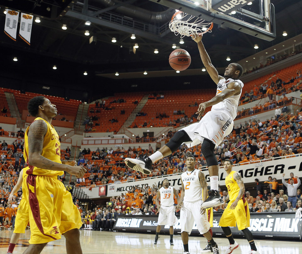 Photo - Oklahoma State Cowboys' Markel Brown (22) dunks the ball during the college basketball game between the Oklahoma State University Cowboys (OSU) and the Iowa State University Cyclones (ISU) at Gallagher-Iba Arena on Wednesday, Jan. 30, 2013, in Stillwater, Okla.  Photo by Chris Landsberger, The Oklahoman