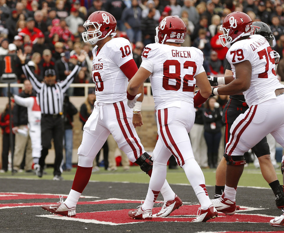 Oklahoma\'s Blake Bell (10) celebrates after scoring a touchdown during a college football game between the University of Oklahoma (OU) and Texas Tech University at Jones AT&T Stadium in Lubbock, Texas, Saturday, Oct. 6, 2012. Photo by Bryan Terry, The Oklahoman