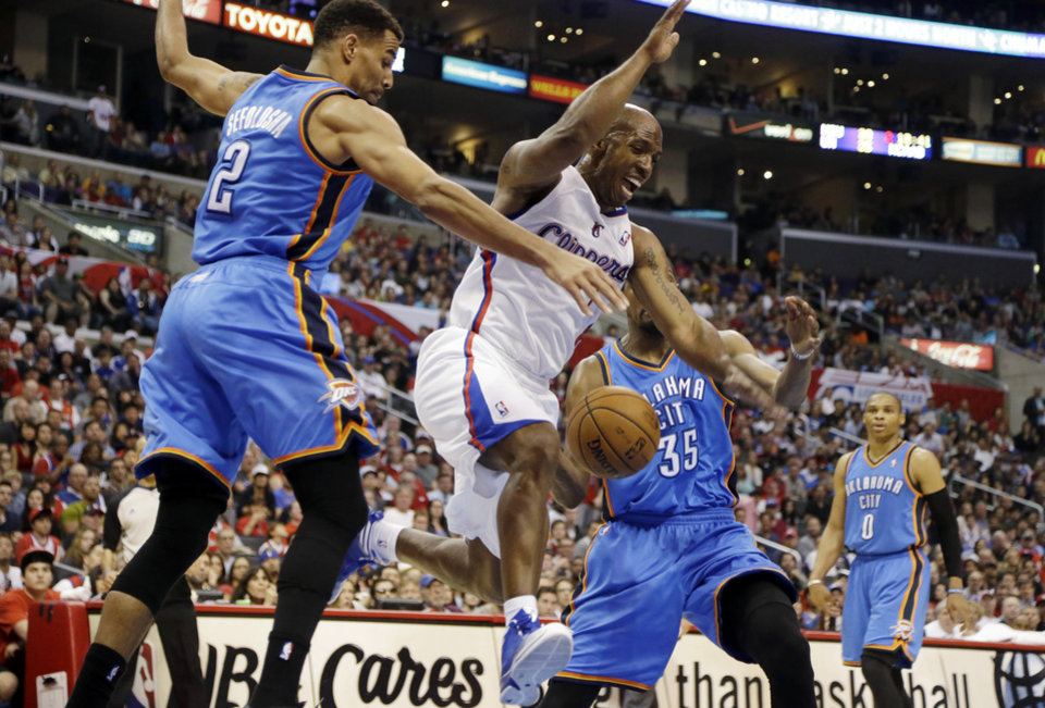Los Angeles Clippers guard Chauncey Billups (1) loses the ball as Oklahoma City Thunder forward Thabo Sefolosha (2), of Switzerland, and forward Kevin Durant (35) defend in the first half of an NBA basketball game in Los Angeles, Sunday, March 3, 2013. (AP Photo/Reed Saxon) ORG XMIT: LAS101