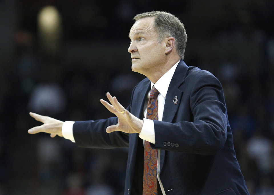 Photo - Oklahoma head coach Lon Kruger coaches during the NCAA men's basketball tournament game between the University of Oklahoma and North Dakota State at the Spokane Arena in Spokane, Wash., Thursday, March 20, 2014. Oklahoma home lost 80-75. Photo by Sarah Phipps, The Oklahoman