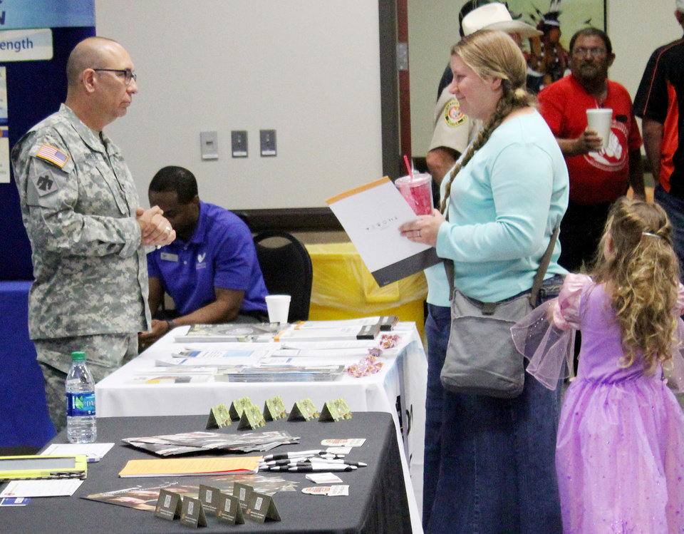 Photo -  Corrynn Franklin, a Navy veteran from Ada, speaks with Col. Warren Griffis of the Oklahoma Army National Guard during Veterans and Military Appreciation Day on May 15 at East Central University. With Franklin is her daughter, Kaydence. Provided by ECU   PROVIDED