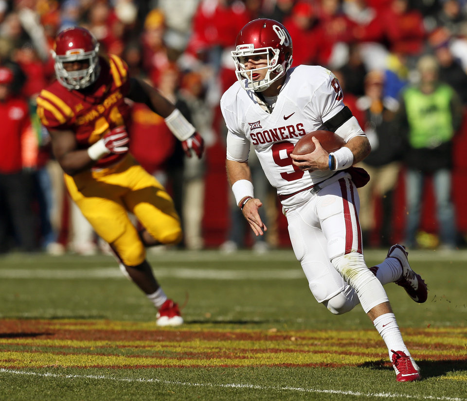 Photo - Oklahoma's Trevor Knight (9) carries the ball in the second quarter during a college football game between the University of Oklahoma Sooners (OU) and the Iowa State Cyclones (ISU) at Jack Trice Stadium in Ames, Iowa, Saturday, Nov. 1, 2014. Photo by Nate Billings, The Oklahoman