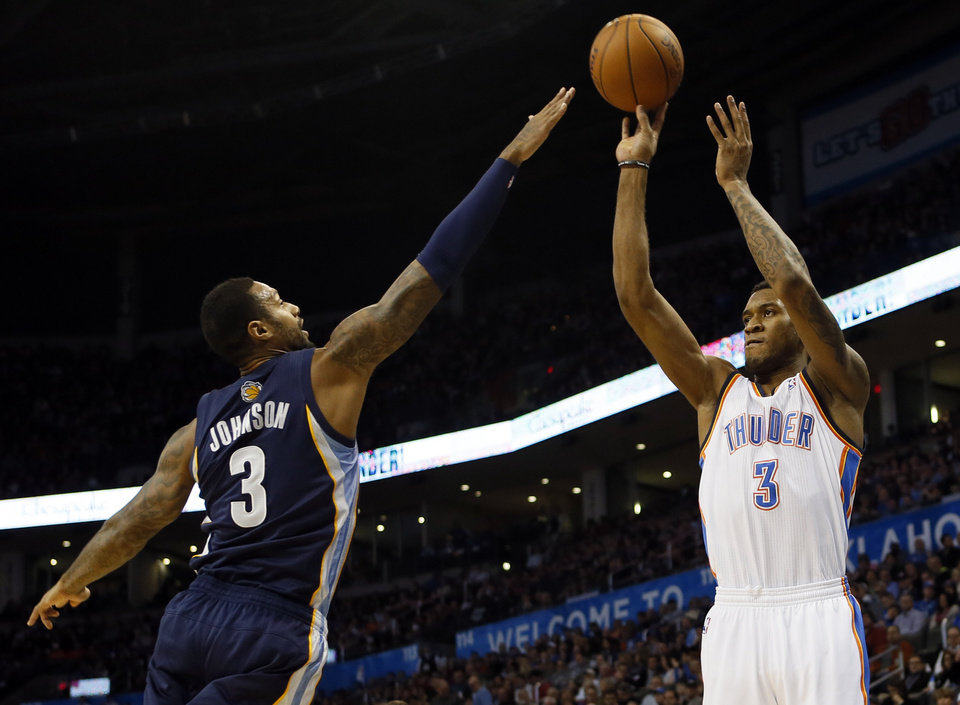 Photo - Oklahoma City's Perry Jones (3) shoots against Memphis' James Johnson (3) in the first half during an NBA basketball game between the Oklahoma City Thunder and the Memphis Grizzlies at Chesapeake Energy Arena in Oklahoma City, Monday, Feb. 3, 2014. PHOTO BY NATE BILLINGS, The Oklahoman