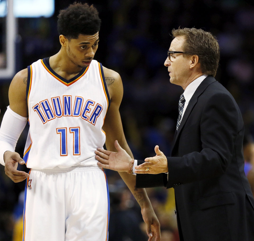 Photo -                    OKC coach Scott Brooks, right, talks to Jeremy Lamb during a game earlier this season against the Detroit Pistons.                     Photo by Nate Billings, The Oklahoman