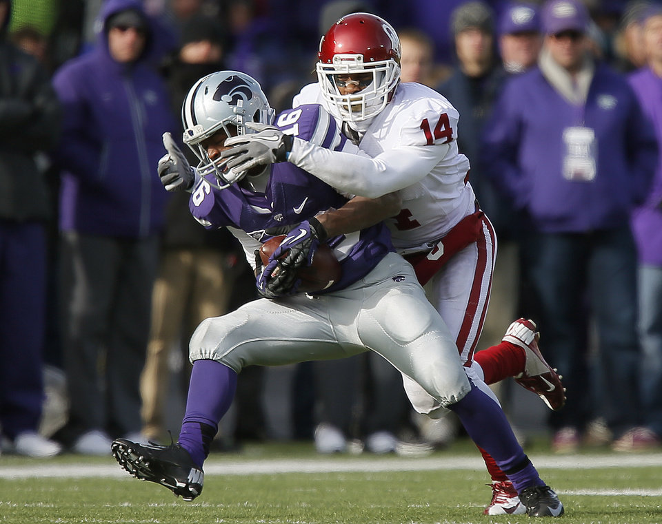 Oklahoma\'s Aaron Colvin (14) brings down Kansas State\'s Tyler Lockett (16) during an NCAA college football game between the Oklahoma Sooners and the Kansas State University Wildcats at Bill Snyder Family Stadium in Manhattan, Kan., Saturday, Nov. 23, 2013. Oklahoma won 41-31. Photo by Bryan Terry, The Oklahoman