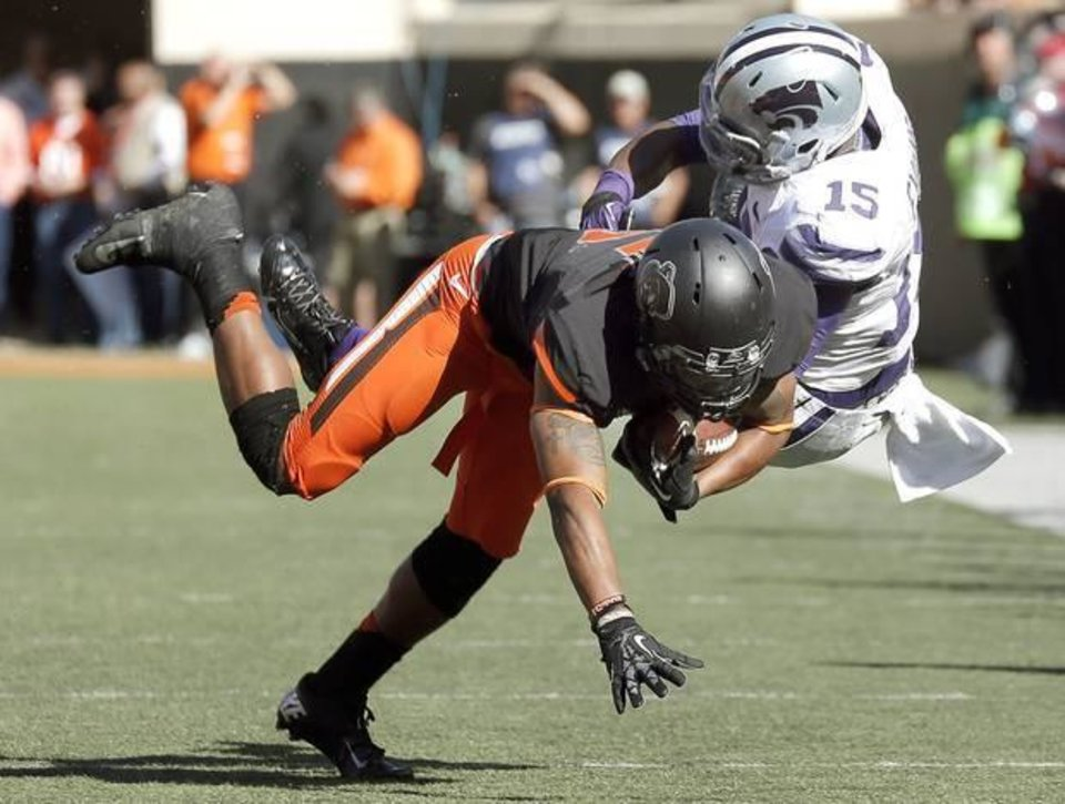 Oklahoma State\'s defense forced five turnovers against Kansas State in a 33-29 win Saturday in Stillwater.