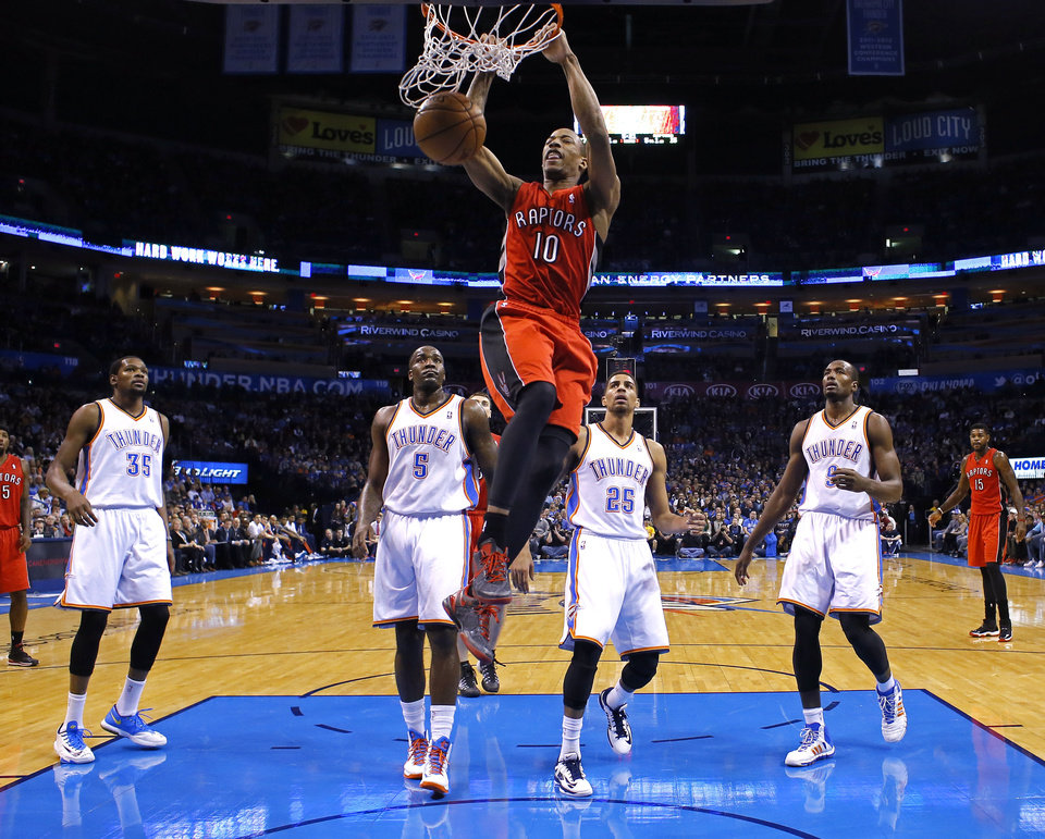 From left, OKC�s Kevin Durant, Kendrick Perkins, Thabo Sefolosha and Serge Ibaka look on as Toronto�s DeMar DeRozan dunks during the Raptors� 104-98 win on Sunday. Photo by Sarah Phipps, The Oklahoman