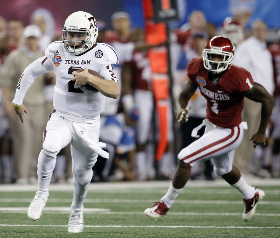 Texas A&M\'s Johnny Manziel (2) runs past Oklahoma\'s Tony Jefferson (1) during the college football Cotton Bowl game between the University of Oklahoma Sooners (OU) and Texas A&M University Aggies (TXAM) at Cowboy\'s Stadium on Friday Jan. 4, 2013, in Arlington, Tx. Photo by Chris Landsberger, The Oklahoman