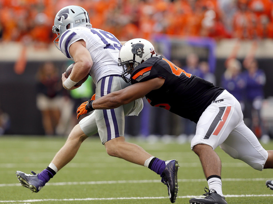 Photo -  Oklahoma State's Chad Whitener (45) brings down Kansas State's Kody Cook (19) during the second half of a college football game between the Oklahoma State Cowboys (OSU) and the Kansas State Wildcats (KSU) at Boone Pickens Stadium in Stillwater, Okla., Saturday, Oct. 3, 2015. OSU beat Kansas State 36-34. Photo by Sarah Phipps, The Oklahoman