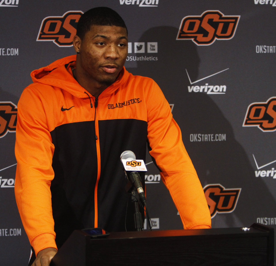 Photo - Oklahoma State basketball player Marcus Smart addresses media members at a press conference held in Gallagher Iba Arena on Sunday, Feb. 9, 2014, in regards to Smart shoving a fan in an altercation during a game Saturday, Feb. 8, 2014. Smart was given a three game suspension by the Big 12 conference and Oklahoma State. Photo by KT King/The Oklahoman