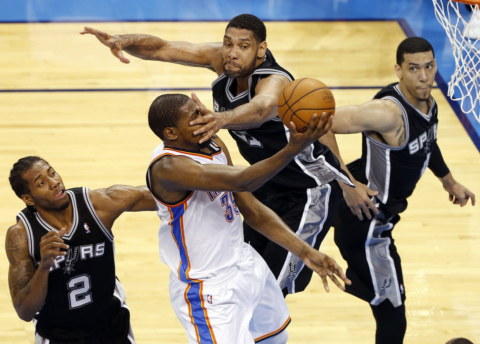 Photo - Oklahoma City's Kevin Durant (35) takes the ball to the basket in the fourth quarter as he is defended by San Antonio's Tim Duncan (21), Kawhi Leonard (2) and San Antonio's Danny Green (4) during Game 6 of the Western Conference Finals in the NBA playoffs between the Oklahoma City Thunder and the San Antonio Spurs at Chesapeake Energy Arena in Oklahoma City, Saturday, May 31, 2014. Photo by Nate Billings, The Oklahoman