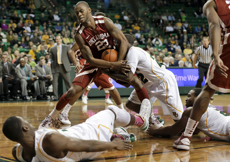 Baylor \'s Deuce Bello, bottom left, and Rico Gathers, bottom right, watch as A.J. Walton, center right, struggles with Oklahoma \'s Amath M\'Baye (22) for control of a rebound during the second half of an NCAA college basketball game Wednesday, Jan. 30, 2013, in Waco, Texas. Oklahoma won 74-71. (AP Photo/Tony Gutierrez) ORG XMIT: TXTG107