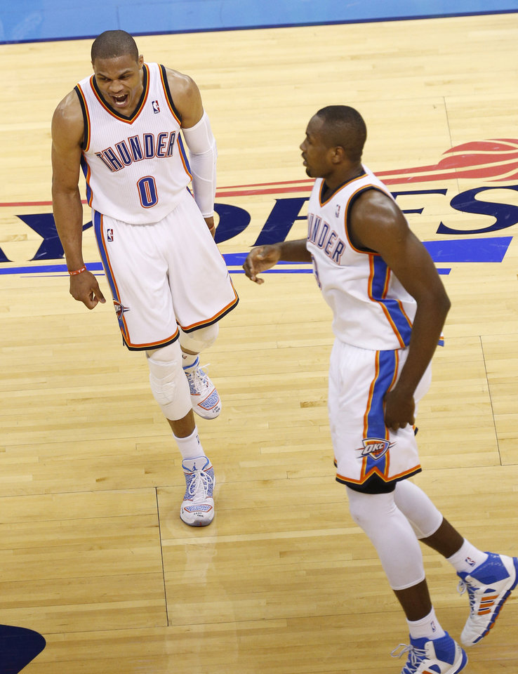 Photo - Russell Westbrook (0) and Serge Ibaka (9) celebrate a run during Game 2 of the Western Conference semifinals in the NBA playoffs between the Oklahoma City Thunder and the Los Angeles Clippers at Chesapeake Energy Arena in Oklahoma City, Wednesday, May 7, 2014. Photo by Sarah Phipps, The Oklahoman
