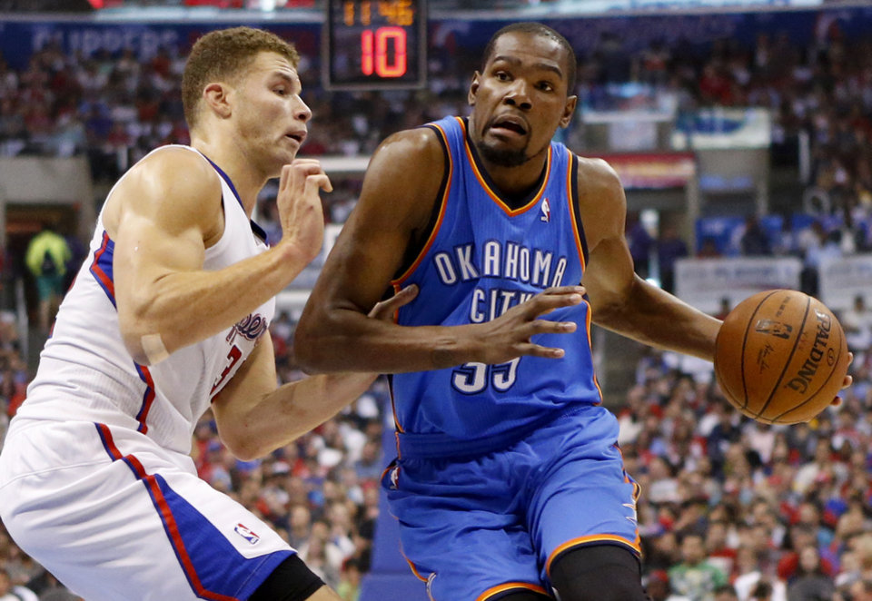 Photo - Oklahoma City's Kevin Durant (35) goes around Los Angeles' Blake Griffin (32) during Game 4 of the Western Conference semifinals in the NBA playoffs between the Oklahoma City Thunder and the Los Angeles Clippers at the Staples Center in Los Angeles, Sunday, May 11, 2014. Photo by Nate Billings, The Oklahoman