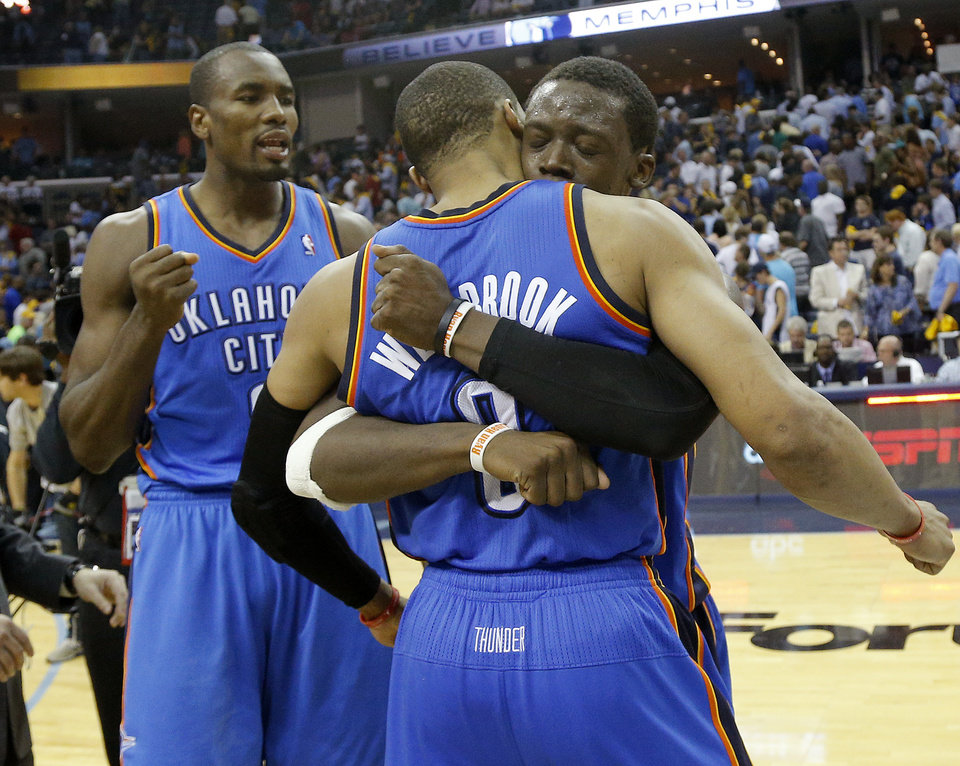 Photo - Oklahoma City's Reggie Jackson (15) celebrates with Russell Westbrook (0) and Serge Ibaka (9) after Game 4 in the first round of the NBA playoffs between the Oklahoma City Thunder and the Memphis Grizzlies at FedExForum in Memphis, Tenn., Saturday, April 26, 2014. Photo by Bryan Terry, The Oklahoman