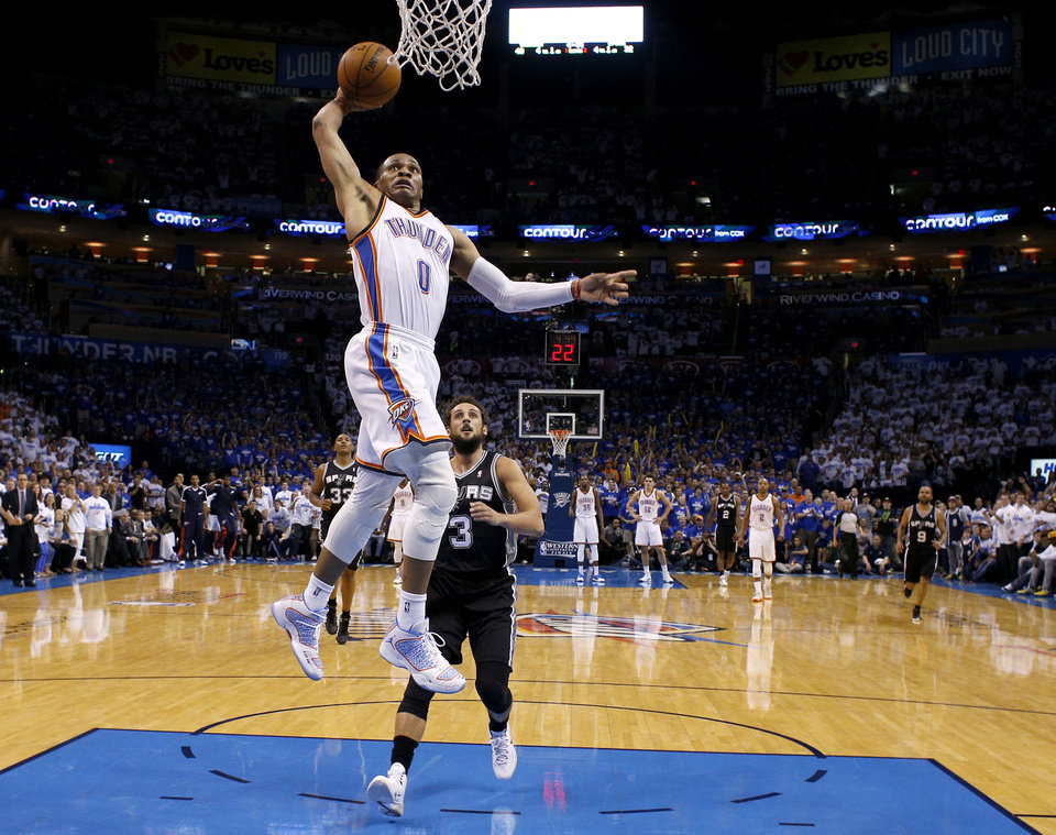 Photo - Oklahoma City's Russell Westbrook (0) goes up for a dunk in front of San Antonio's Marco Belinelli (3) during Game 4 of the Western Conference Finals in the NBA playoffs between the Oklahoma City Thunder and the San Antonio Spurs at Chesapeake Energy Arena in Oklahoma City, Tuesday, May 27, 2014. Photo by Bryan Terry, The Oklahoman