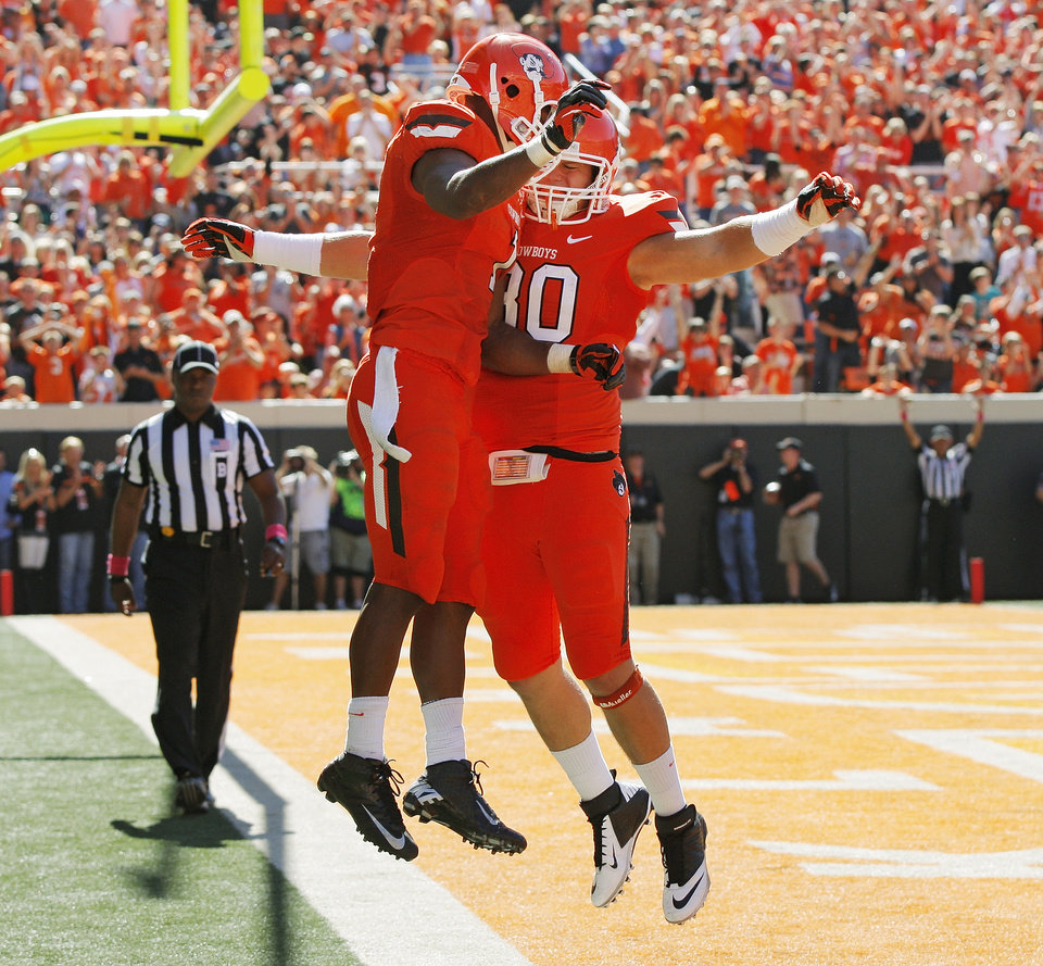 Oklahoma State's Joseph Randle (1), left, and David Paulsen (30) celebrate a touchdown by Randle in the third quarter  during a college football game between Oklahoma State University (OSU) and Iowa State University (ISU) at Boone Pickens Stadium in Stillwater, Okla., Saturday, Oct. 20, 2012. OSU won, 31-10. Photo by Nate Billings, The Oklahoman