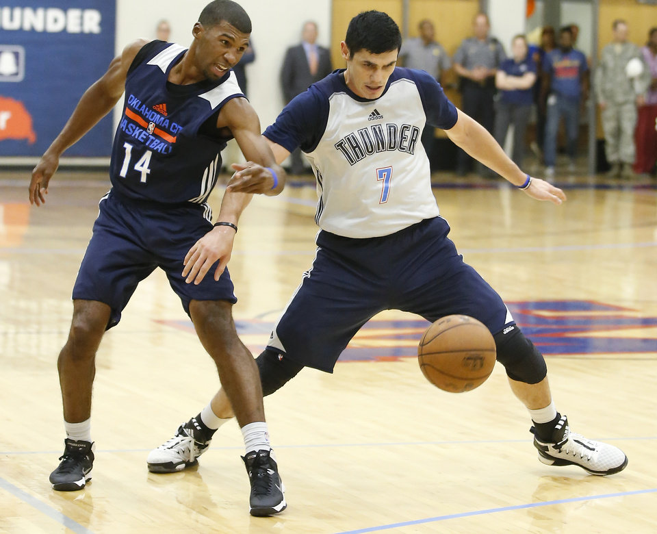 Photo - Oklahoma City's Ronnie Price, left, and Ersan Ilyasova go for the ball during the Thunder's annual Blue and White Scrimmage at John Marshall Mid-High School in Oklahoma City, Tuesday, Sept. 27, 2016. Photo by Bryan Terry, The Oklahoman
