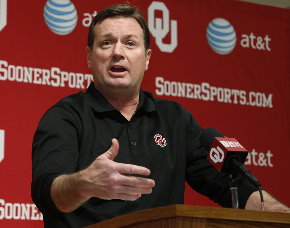 Photo - OU coach Bob Stoops talks about his 2014 recruiting class Wednesday in Norman. Photo by Steve Sisney, The Oklahoman