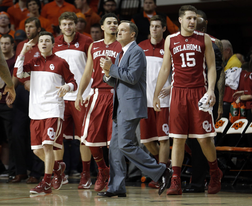 Photo - Oklahoma head coach Lon Kruger takes a time out during the men's Bedlam college game between Oklahoma and Oklahoma State at Gallagher-Iba Arena in Stillwater, Okla., Saturday, Feb. 15, 2014. Photo by Sarah Phipps, The Oklahoman