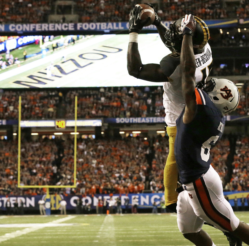 Photo - Missouri wide receiver Dorial Green-Beckham (15) makes a touch-down catch against Auburn defensive back Jonathon Mincy (6)during the first half of the Southeastern Conference NCAA football championship game, Saturday, Dec. 7, 2013, in Atlanta. (AP Photo/Dave Martin)