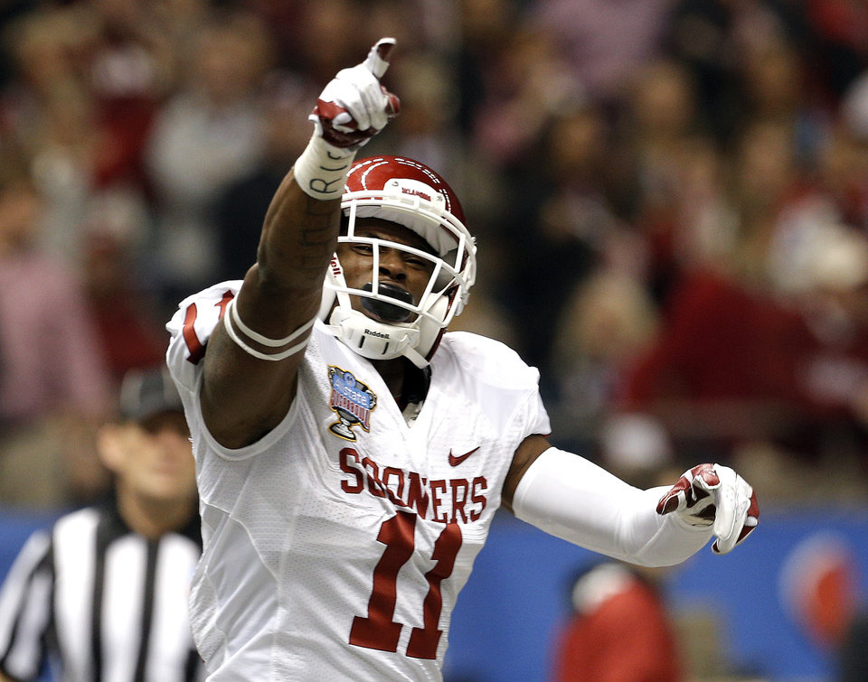 Oklahoma\'s Lacoltan Bester (11) celebrates a touchdown during the NCAA football BCS Sugar Bowl game between the University of Oklahoma Sooners (OU) and the University of Alabama Crimson Tide (UA) at the Superdome in New Orleans, La., Thursday, Jan. 2, 2014. Photo by Sarah Phipps, The Oklahoman