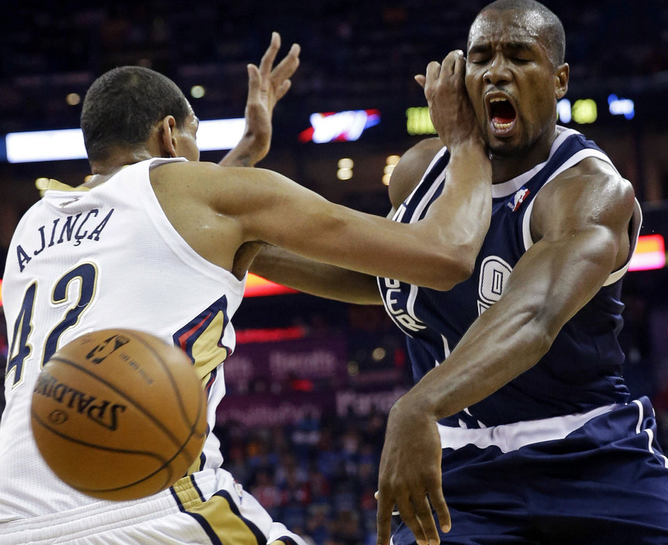 Photo - Thunder forward Serge Ibaka, right, is fouled by Pelicans center Alexis Ajinca in the first half Monday in New Orleans.                    AP Photo